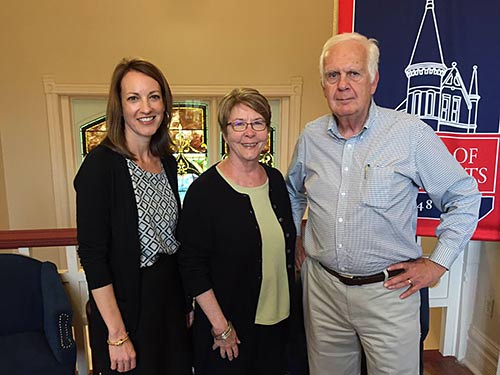 Susan Nicholas (left), North Mississippi VISTA Project assistant director at UM, welcomes new volunteers Allen and Susan Spore.